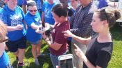 Interpreters help EKU staff introduce piglet to the campers.